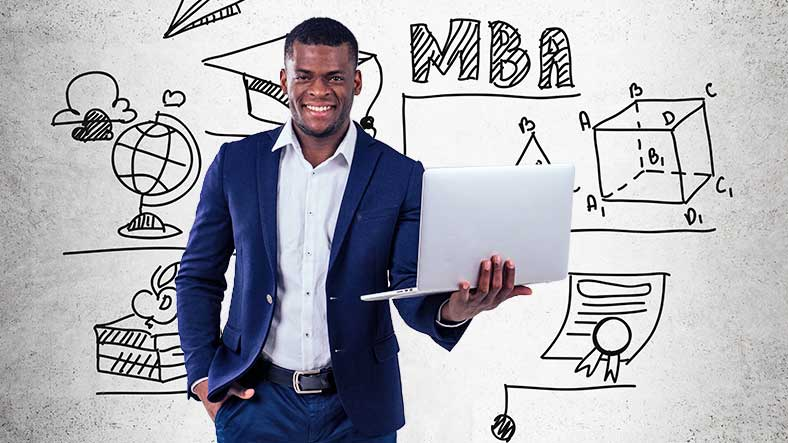 MBA general student holding a laptop