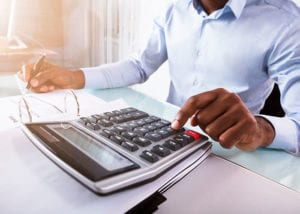 MSc in accounting and finance student working on calculator